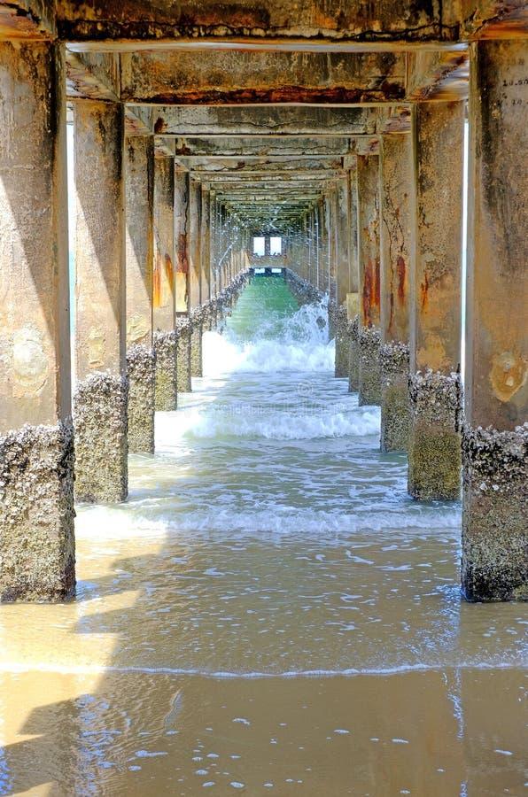 Under concrete bridge at the local pier stock image