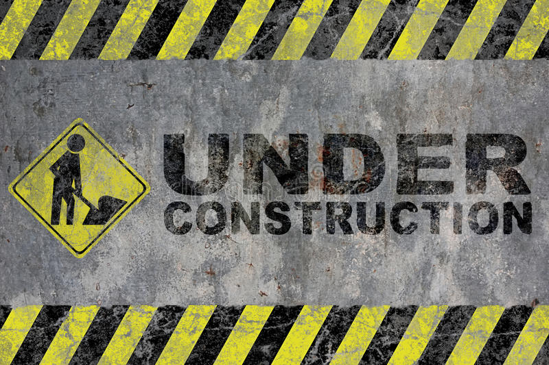 Under construction. A grunge background with yellow and black stripes and the Under construction warning