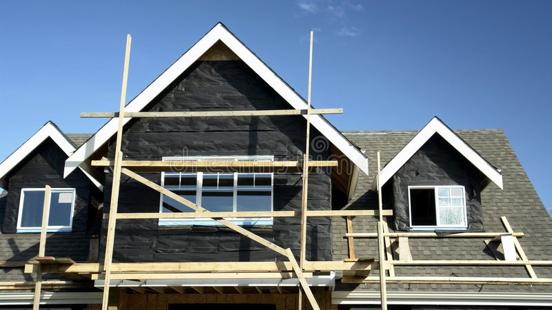 Under Construction. New house under construction just before siding installation royalty free stock image