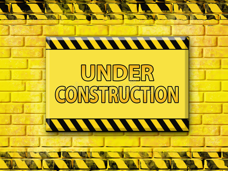Under construction. In yellow and black with brick wall