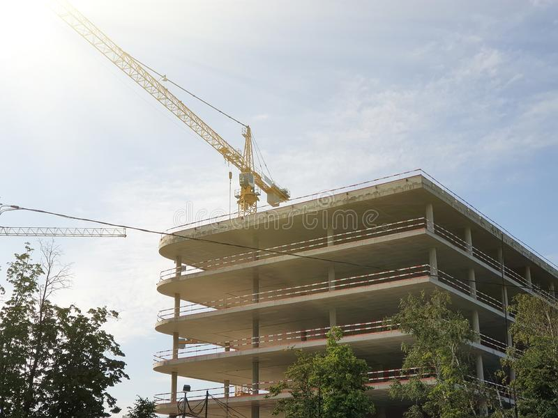 under construction basis of building ground multi-level Parking and crane in background royalty free stock photography
