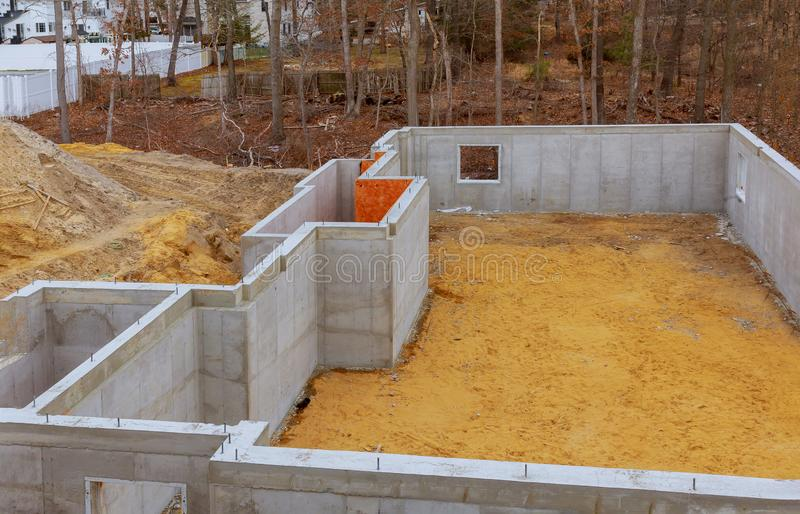 Under construction foundation new home with cement. Basement foundation architecture building activity concrete wall floor house job site industrial soil stock images