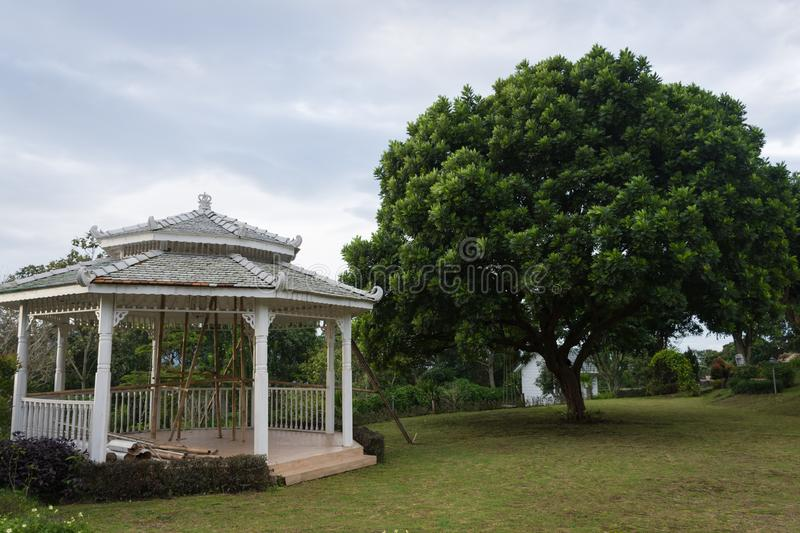 Under construction gazebo on the beautiful garden. Backyard views of Bandungan Hills Hotel and Resort on Semarang, Indonesia. Park, summer, wooden, pavilion royalty free stock photos