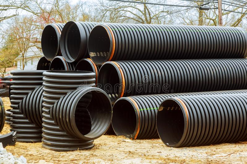 Under construction of housing of stacked plastic pipes on building. Under construction of housing of stacked PVC pipes on building drainage canalization sewage stock photography