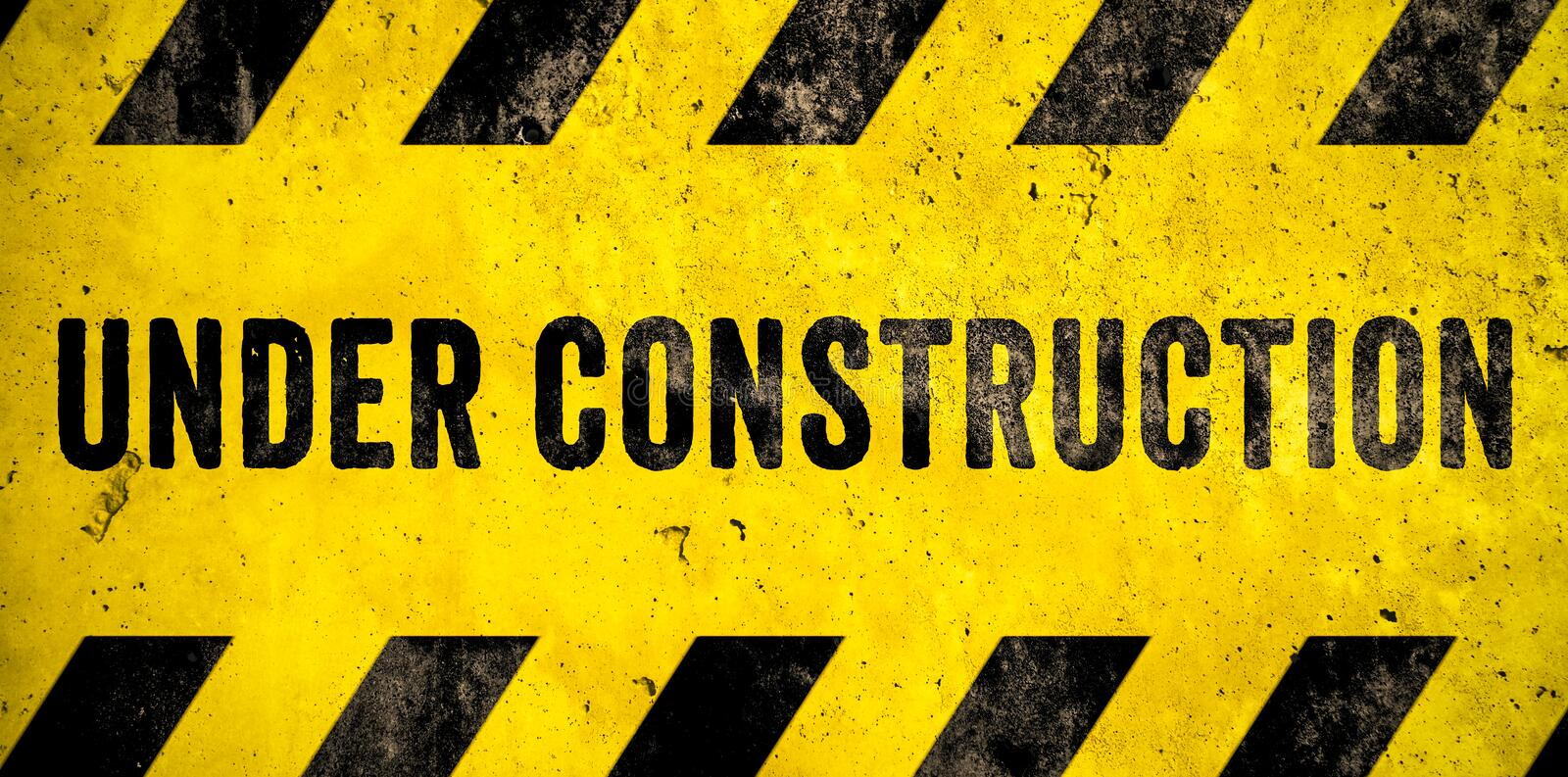 Under construction warning sign text with yellow black stripes painted over concrete wall cement facade texture background banner. Under construction warning vector illustration