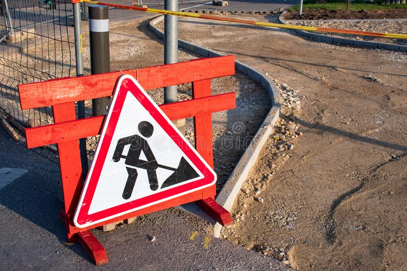 Under construction. Work in progress. Roadworks, road signs. Men at work royalty free stock photography