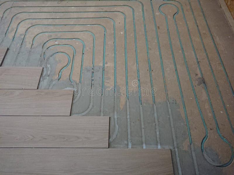 Under floor heating. Underfloor water heating pipe layout before tiling the floor over stock image