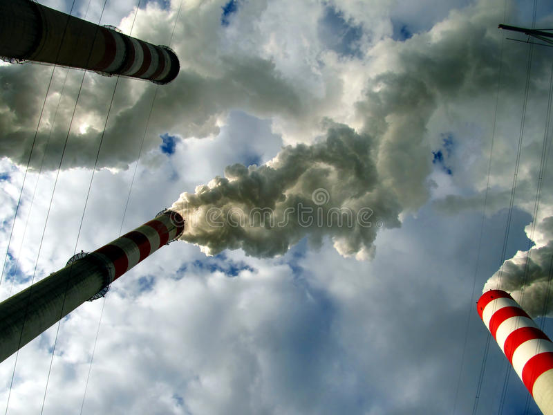 Under fuming (smoke) chimney. Sky engages covered < cover > and from high chimneys smoke (smoke) leaving (go out royalty free stock image