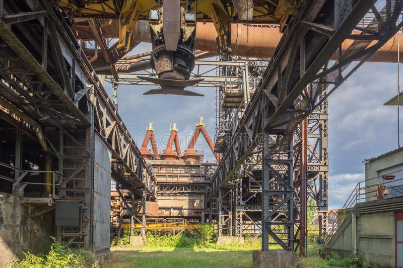 Under a giant electromagnetic crane. In the blast furnace park of Uckange stock image