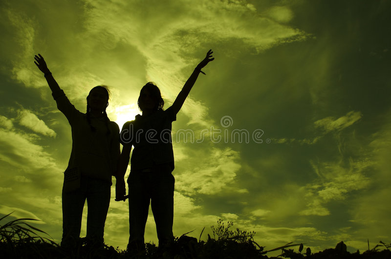 Under the green sky. Two teenagers under mystic sky stock image