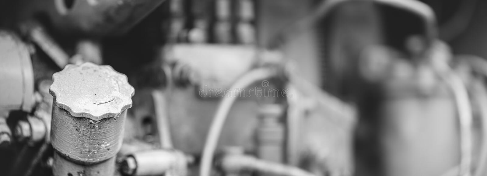 Under the hood of old tractor, retro engine close up. Wide angle retro background on heavy industry theme with space for text. stock photos