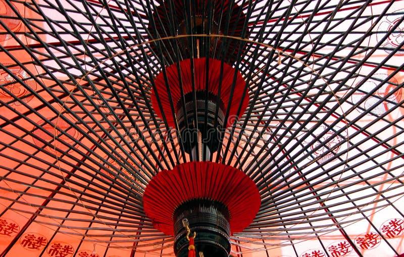 Under Japanese umbrella royalty free stock photo