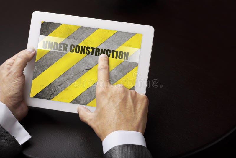 Under konstruktion (internetbegreppet) royaltyfri fotografi