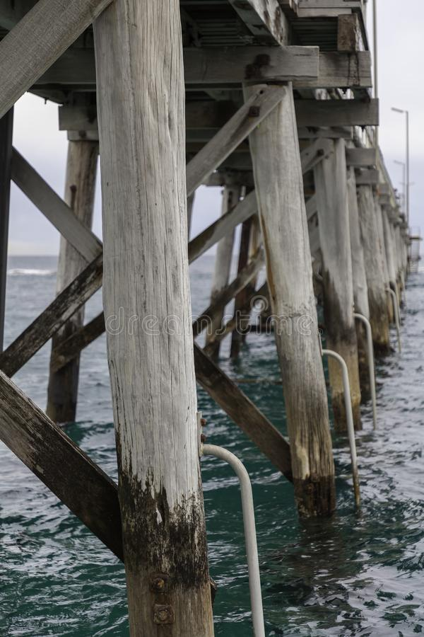 Under neith Port Noarlunga Jetty. Beams and Structures. stock image