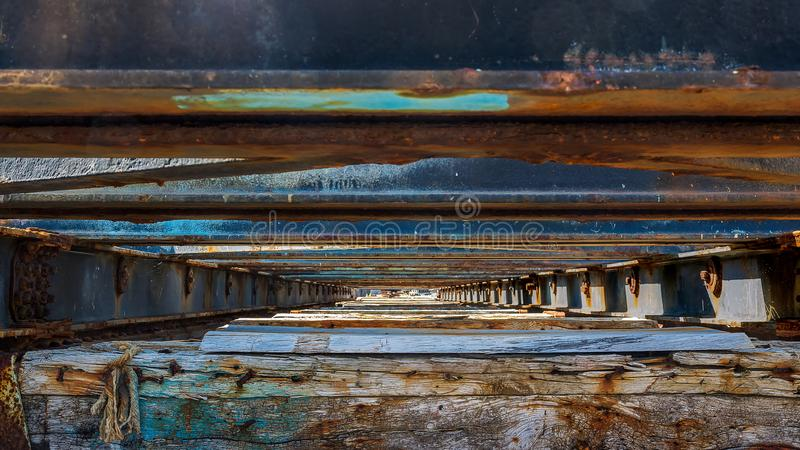 Under the old boat hold. At the bottom of the rails of a boat dock in the port of Audierne in Brittany, France royalty free stock photography