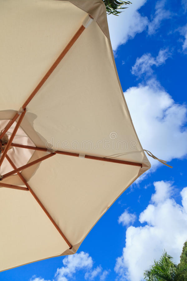 Download Under parasol stock image. Image of season, cloud, shelter - 25425599