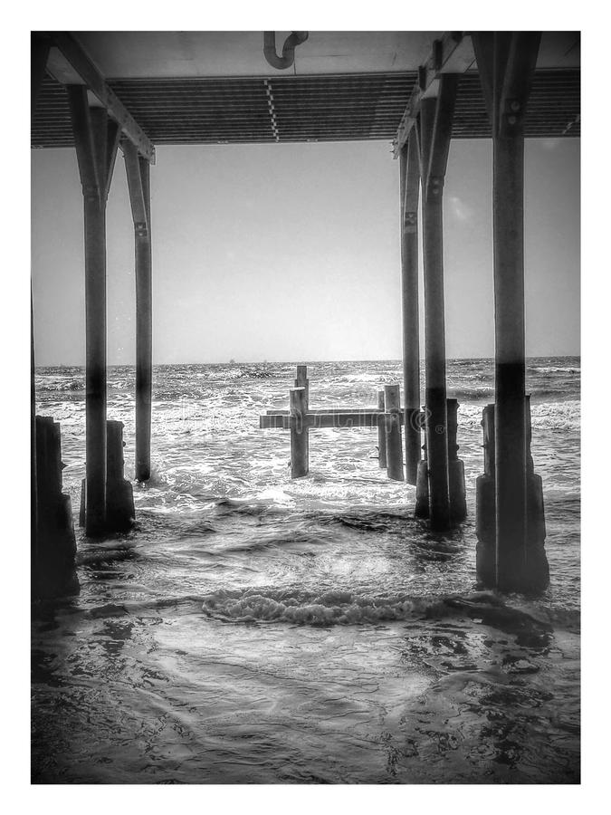 Under the Pier. Not as catchy a tune as Under the Boardwalk but a great place to relax and read a book stock photos