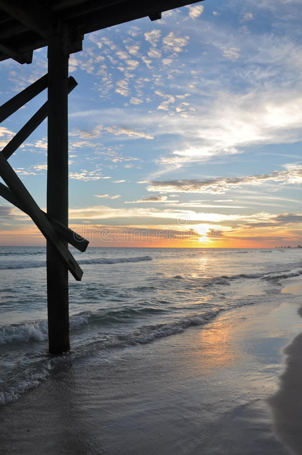 Under pier sunset royalty free stock photography