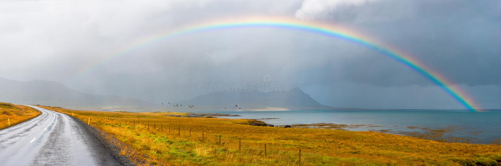 Under the rainbow. Synchronicity. The blissful feeling of being at the right place at the right time. Just another magical moment on utterly beautiful Iceland stock photos