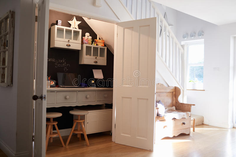 Under Stairs Home Office In Contemporary Family Home royalty free stock images