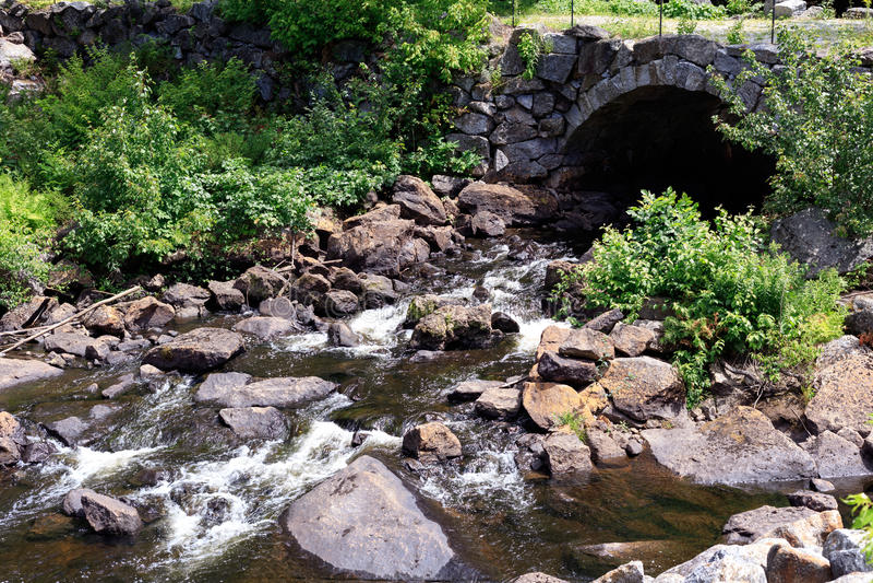 Under the stone bridge river stock image