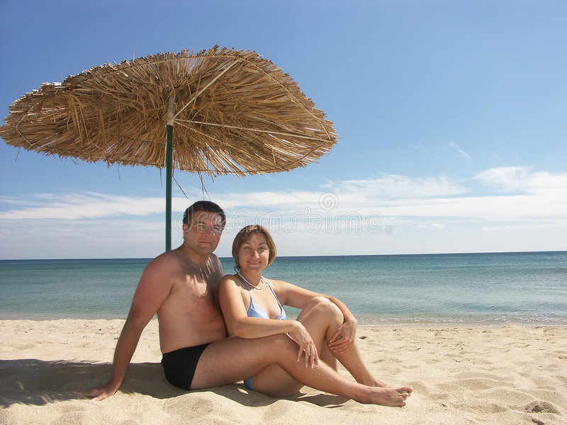 Download Under straw umbrella stock image. Image of family, husband - 1238101