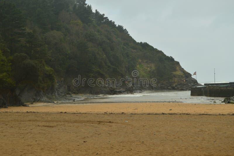 Underbart fototillfångatagande av den storartade stranden av Ea Naturlandskaplopp arkivfoto