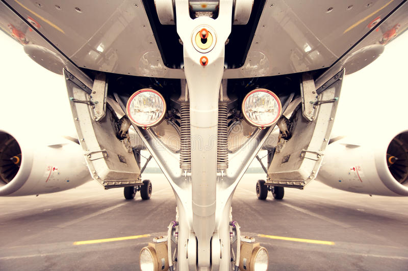 Undercarriage of jetplane, aircraft. Symmetrical stock images