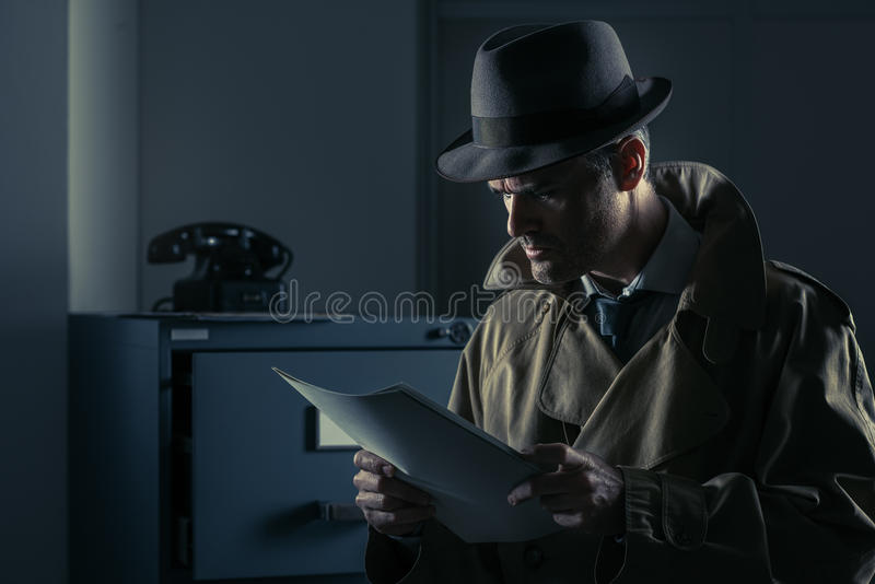 Undercover spy stealing files stock image