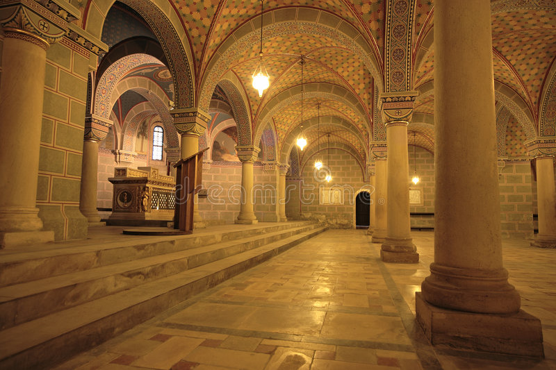 Undercroft. Church interior with arch and pillars stock image