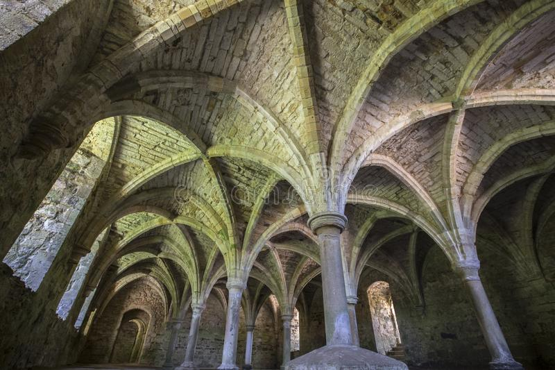 Undercroft of Battle Abbey in East Sussex. The remains of the undercroft at the historic Battle Abbey in East Sussex, UK stock images