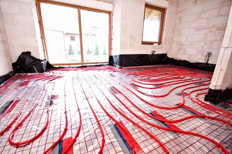 Underfloor heating. Being installed in a house under construction stock photography