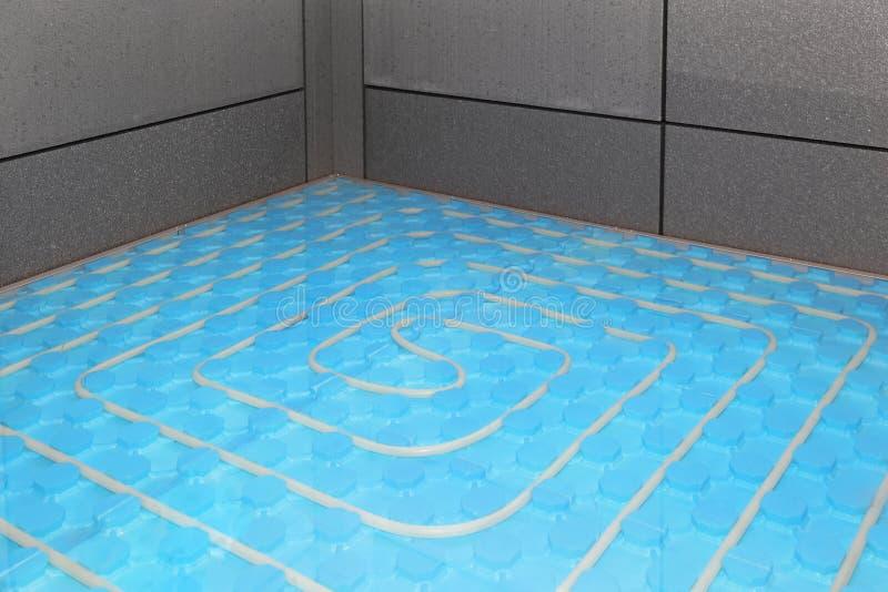 Underfloor heating. Installation of new underfloor central heating system royalty free stock photos