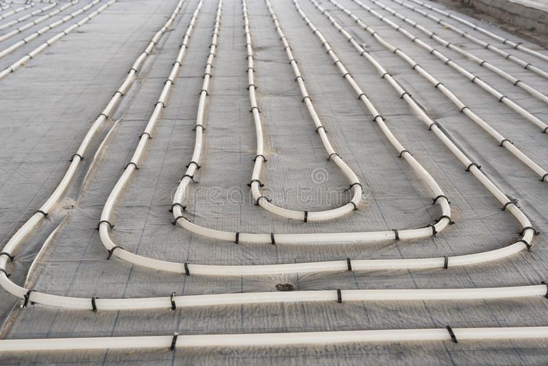 Underfloor heating system installation. Close up on water floor heating system royalty free stock photo