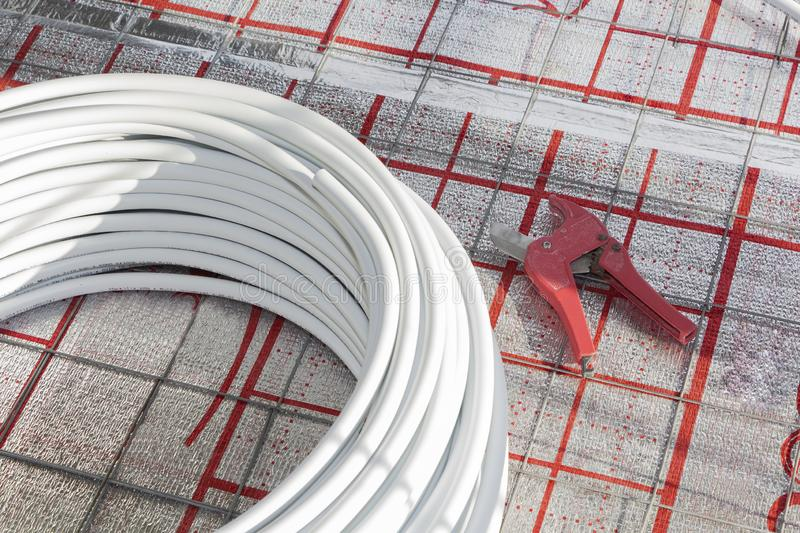 Underfloor heating system in new residential house stock image