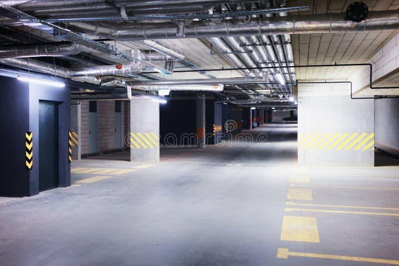 Underground car parking garage in European modern apartment building royalty free stock photos