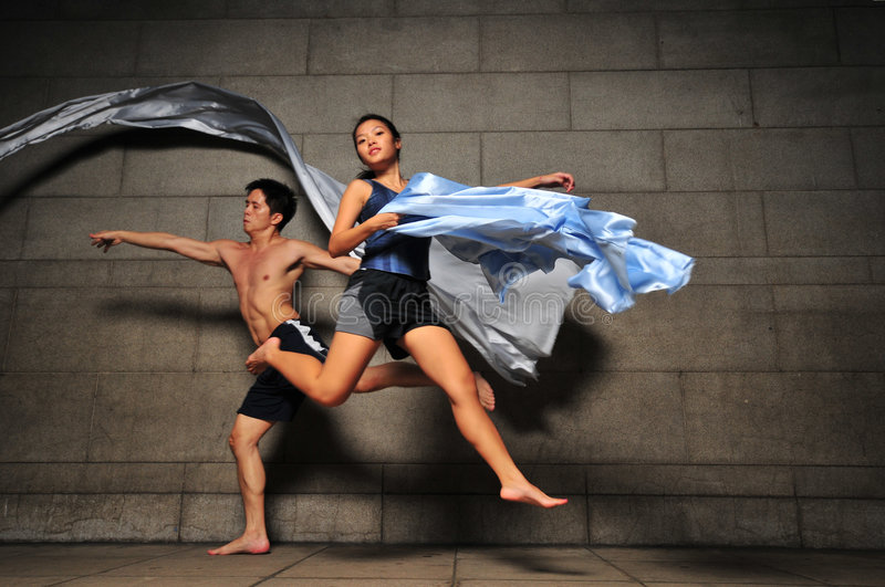 Underground Dance 106. Artistic Picture of dancers performing athletic contemporary dance moves stock image