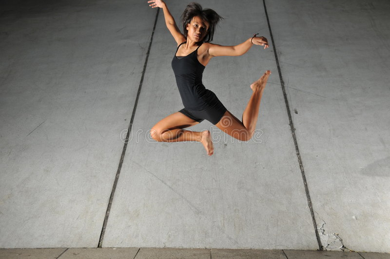 Underground Dance 35. Artistic Picture of a Dancer performing athletic contemporary dance moves stock images