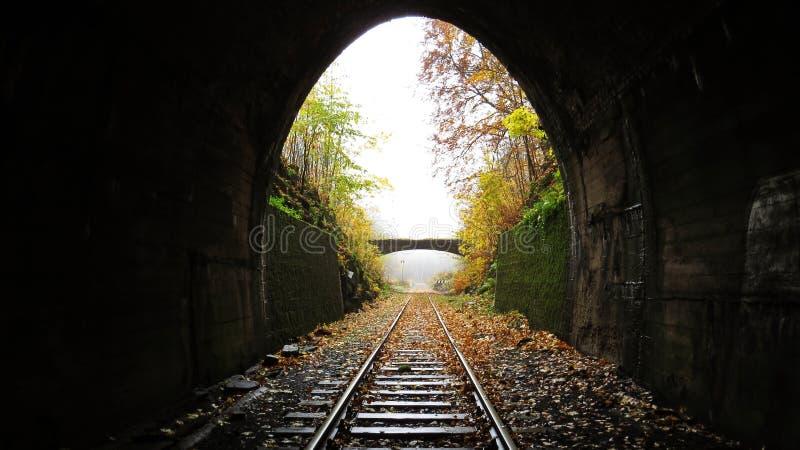 Underground Dark Train Rail Way Tunnel Exit with Light in the End. Underground Dark Train Rail Way Tunnel Exit with a Light in the End royalty free stock photos