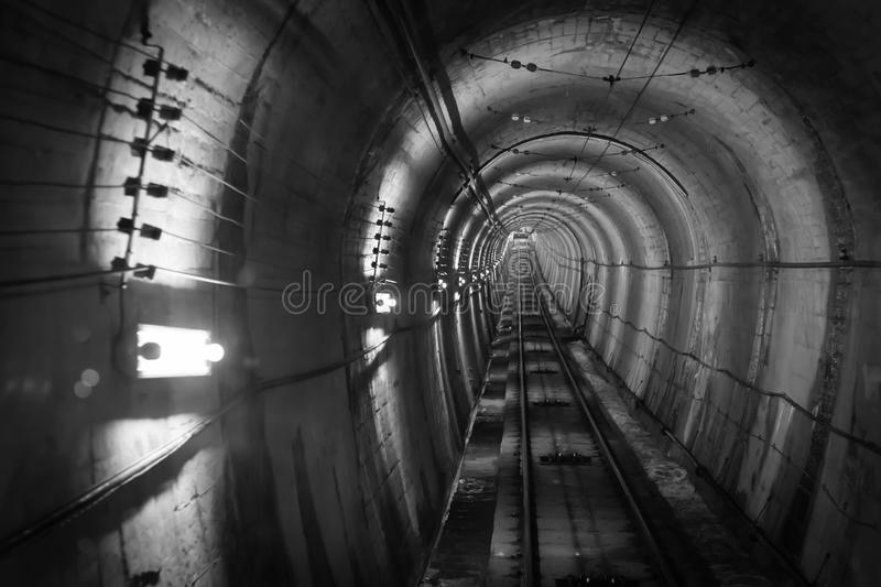 Underground facility with a big tunnel leading deep down. royalty free stock photography