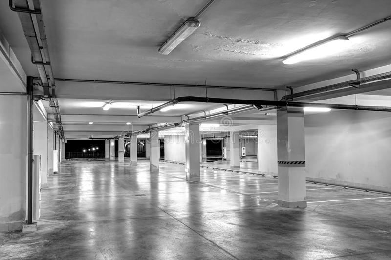 Underground garage. Empty underground parking stock photo