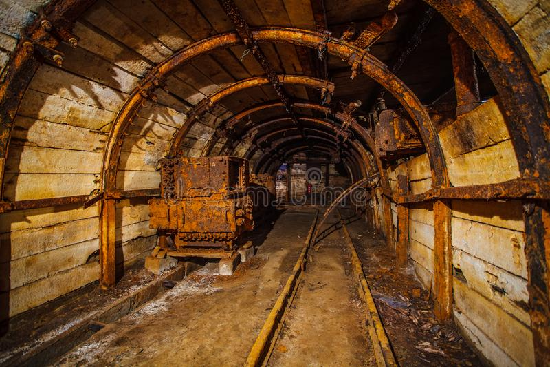Underground mining tunnel with rails. Abandoned coal mine. Tunnels and passages in a coal mine.  stock image