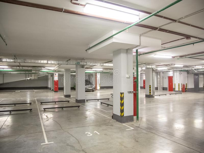 Underground parking for cars in a residential building. Close-up underground parking for cars in a residential building royalty free stock photos