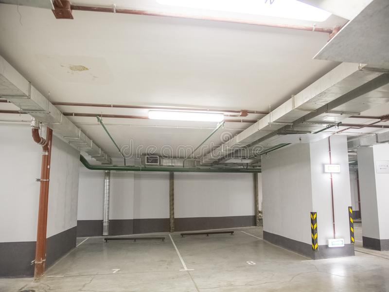 Underground parking for cars in a residential building. Close-up underground parking for cars in a residential building stock images