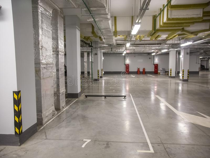 Underground parking for cars in a residential building. Close-up underground parking for cars in a residential building royalty free stock image