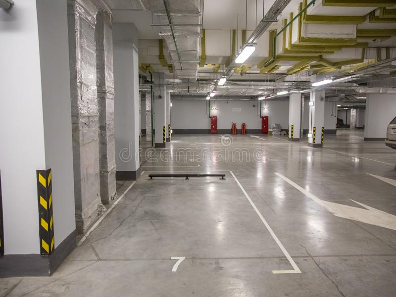 Underground parking for cars in a residential building. Close-up underground parking for cars in a residential building stock photography