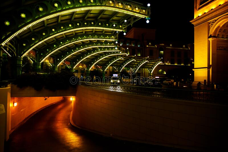 Underground parking lot full of lights at night. royalty free stock image
