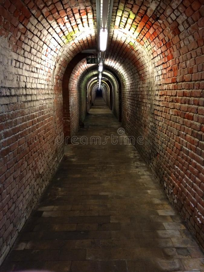Underground passage in old building royalty free stock images