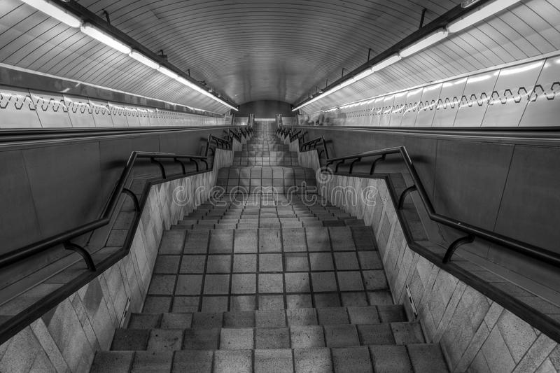 Underground stairs. Symmetrical composition of stairs in the underground of Madrid, capital of Spain, with converging lines leading the eye of the viewer stock photography