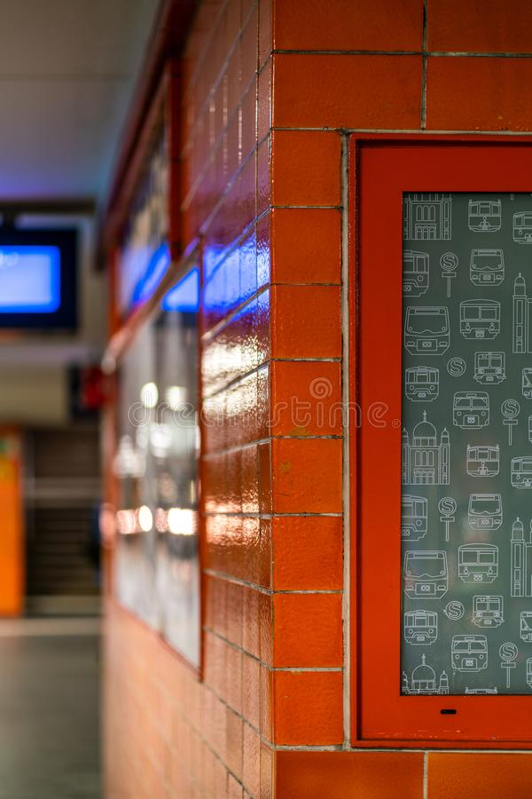 Underground station Oranienburger Strasse, Berlin, Germany - july 07, 2019:  detail of the building on the platform with orange stock photography